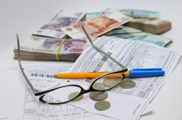Как производится оплата за коммунальные услуги